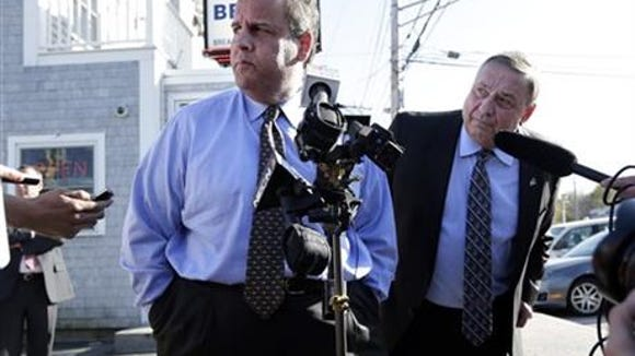 Gov. Chris Christie, left and Maine Gov. Paul LePage take questions from reporters outside Becky's Diner on May 7, 2014, in Portland, Maine. (Associated Press)