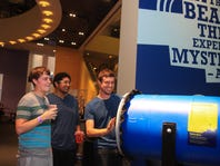 Reina Wirtjes/Special to the Register Mix your Friday night up with drinks, mingling, science and entertainment at the Science Center of Iowa. Tyler Johnson, 26, Chris Lopez, 24, and Eric Weflen, 25, puff air across the room at Mixology. Tyler Johnson, 26, Chris Lopez, 24, and Eric Weflen, 25, puff air across the room at Mixology Night at the Science Center of Iowa on Friday July 18, 2014.