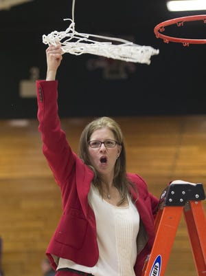 CVU coach Ute Otley celebrates the Redhawks' victory over Essex the girls Division I state basketball championship at Patrick Gymnasium in Burlington on Tuesday, March 10, 2015.