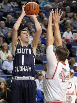 South Oldham's Devin Young shoots near South Laurel's Caleb Taylor during their quarter-final round of the Sweet 16 in Lexington. March 18, 2016