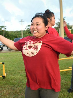 Recruit Jerena Eustaquio warms up with jumping jacks during Pacific Daily News' 2017 Bridal Boot Camp at Gov. Joseph Flores Beach Park in Tumon on Jan. 4, 2017.