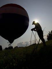 Patrick Fogue of Columbia, Missouri, prepares his hot air balloon for rides for visitors of the Balloonfest in Ashland in 2004.