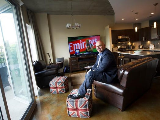"""Re/Max Elite Realtor Gary Ashton moved from five acres in Gallatin to this Icon condo in the Gulch. """"I love it. It's like a village lifestyle. I can go to the pool, stay at home and watch soccer, or walk to the pub and different restaurants,"""" he said."""