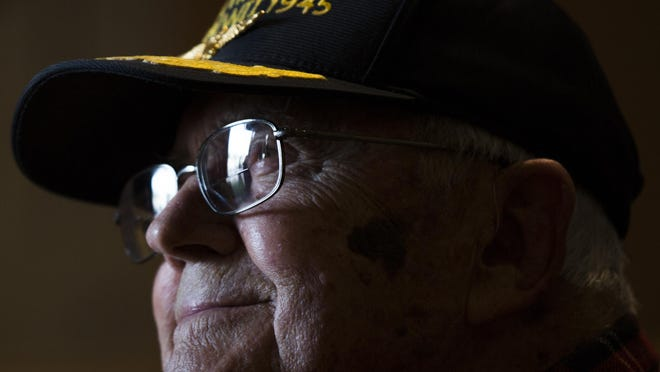 Robert Reed, a World War II U.S. Navy veteran, looks up as a server takes his order at EJ's Bayfront Cafe on Saturday, December 10, 2016 in East Naples. He was unaware that there was a birthday cake waiting for him after his meal. Reed celebrated his 98th birthday with his two friends, Ronn Ginn and Dave Marger, by flying to Naples from St. Petersburg for breakfast. Ronn Ginn orchestrated the surprise at the restaurant.