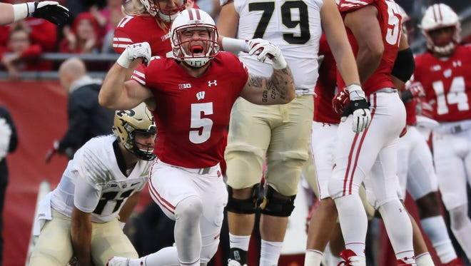 UW linebacker Garret Dooley celebrates after sacking Purdue quarterback David Blough in a recent game in Madison.