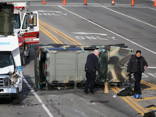 A motor vehicle accident closed part of Empire Boulevard near Route 590. Police were pursuing a robbery suspect when the suspect lost control of his sports utility vehicle Monday morning.