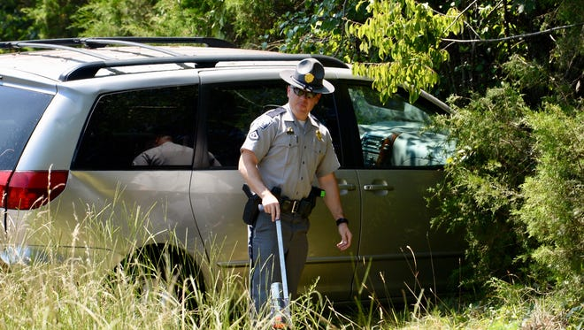 Highway Patrol troopers work the scene of a fatal wreck in Anderson County