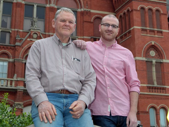 Bob McElroy (left) and his son, Bobby McElroy outside of Music Hall.  Bob McElroy's great-grandfather Patrick Henry McElroy was a construction supervisor when Music Hall was built.