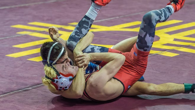 Piedra Vista's Dylan Greenhaus pins Albuquerque Academy's Clay Crosby for the 120-pound state title on Saturday at the Santa Ana Star Center in Rio Rancho.