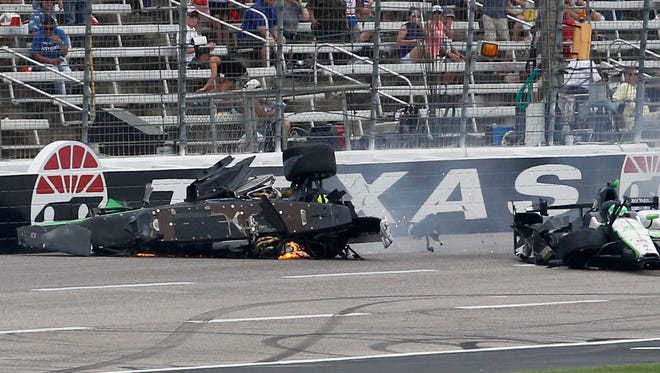 Josef Newgarden's car, left. slid down the track after being involved in a wreck with Conor Daly during an IndyCar auto race June 12 at Texas Motor Speedway.