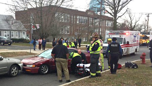 A two-vehicle motor vehicle crash, involving a pedestrian, sent two people to area hospitals as Cunningham Academy dismissed students Thursday.