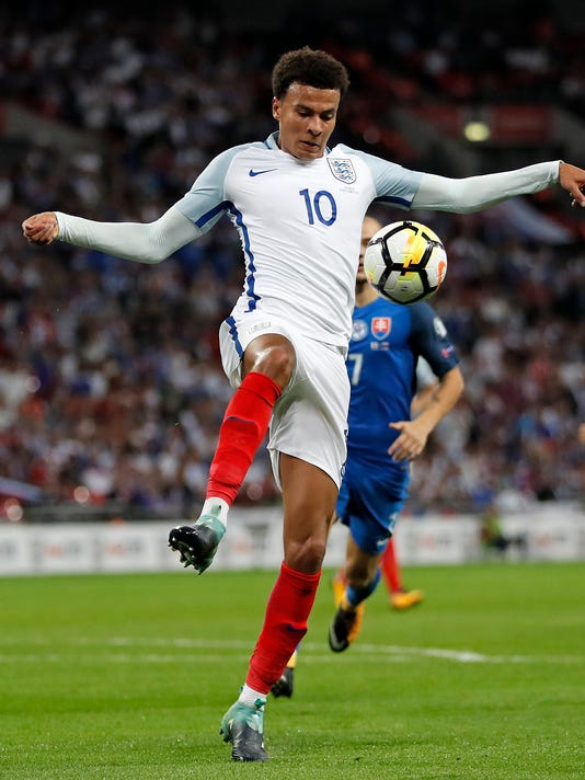 England's Dele Alli controls the ball during the World Cup Group F qualifying soccer match between England and Slovakia at Wembley Stadium in London, England, Monday, Sept. 4, 2017. (AP Photo/Kirsty Wigglesworth)