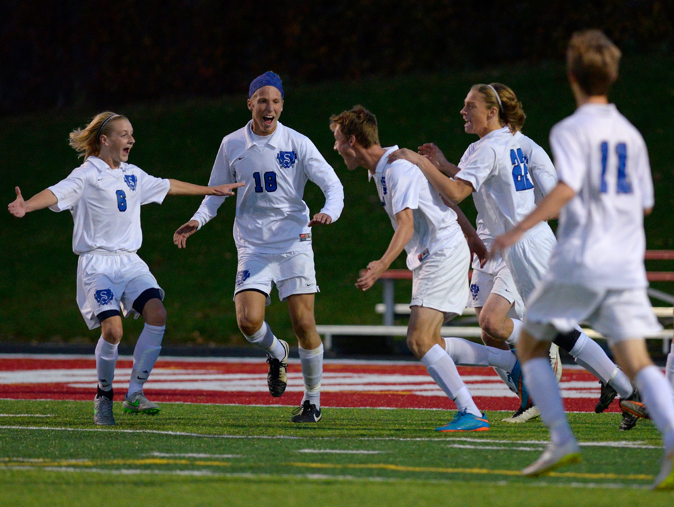Sartell players celebrate their second goal of the game in the first half of their Sect. 8A championship game against St. Cloud Apollo Thursday, Oct. 22 at Husky Stadium.