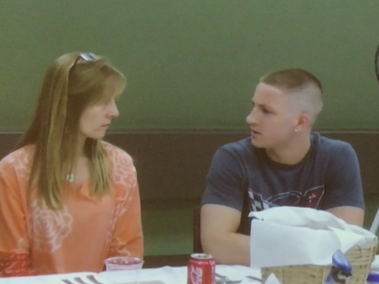 Dr. Laurie Mulvey, left, speaking with a student during the Peace Table event at Middlesex High School.