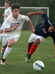 White House's Matt Hooper (left) attacks as White House Heritage's Andy Aguilar looses his balance in White House, TN on Wed. April 19, 2017.