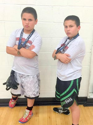 The Sandoval brothers won first place in the North Valley Trojan Wrestling Tournament this past weekend in Las Cruces.
