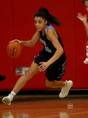 Mount Notre Dame 's  Laila Phelia bring the ball up the court  during the Cougars win over Dayton Wayne during thier district championshp game, Saturday, March, 3, 2018.