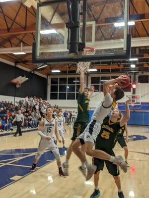 Quabbin Regional senior point guard T.J. Chamberlain, shown attacking the basket, scored 17 points off the bench to lead the Panthers past Tantasqua in the quarterfinals of the Western Mass. Division 2 Tournament in February.