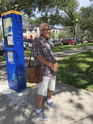 Raymond Holmes takes his daily walk Wednesday in St. Petersburg, Fla.