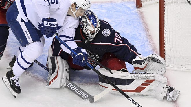 Blue Jackets goaltender Joonas Korpisalo, shown making a stop on Maple Leafs right winger Ilya Mikheyev in Game 3 on Thursday, returned to the starting lineup in the deciding game and recorded his second shutout.