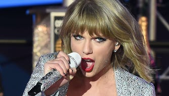 Taylor Swift performs on  New Year's Eve in NYC.