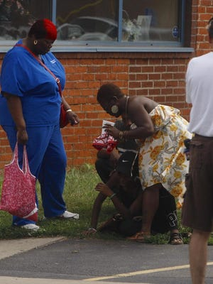 A woman reacts near the scene of the shooting.