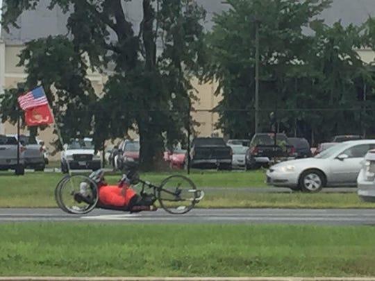 U.S. Marine Sgt. Toran Gaal hand-cycling northbound on U.S. 13 north after 9 a.m. Wednesday