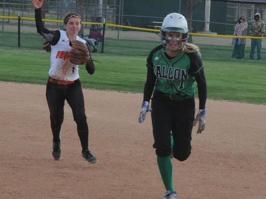Fernley second baseman Hailey Edgar throws to first after getting Fallon's Izzy Thomas in a rundown during a game.
