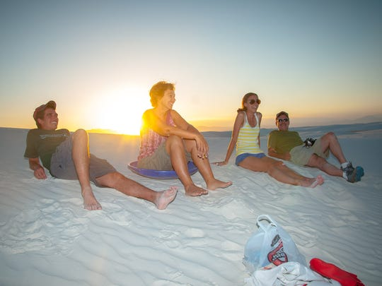 Family and friends relax and wait for the moon to rise at White Sands National Monument.
