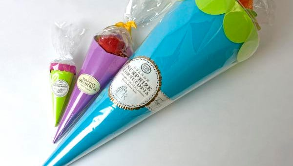 Perfect as party favors, or give a large one as a main gift. These paper cones are filled with whimsical treats and prizes like vintage-style toys, paper crowns, organic candy, wish papers, rub-on tattoos and the like. Tops Malibu Surpize Cornucopias, from $23, Hester & Cook.
