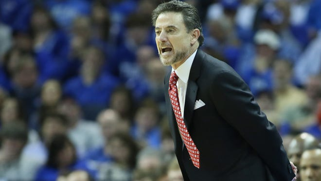 Louisville Cardinals head coach Rick Pitino looks on during the first half against the Memphis Tigers at FedExForum.