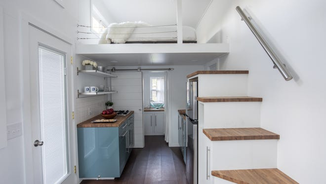 This is the interior of the 192 square-foot tiny home curated by comedian Kevin Hart. It has a standard bed, kitchen, living room, and full bath. It will be available on Booking.com starting Sept. 27.