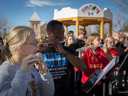 Members of the 130-strong Centennial High School Band play on Mesilla Plaza as part of a 12 hour music marathon that started at Farmers & Crafts Market and finished at the Pan American Center.  Band leader Joseph Flores hopes the marathon will raise up to $15,000 to support the school's music program.