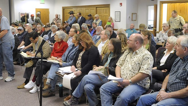 More than 20 people spoke in opposition to Desert Wells Preserve during a previous county commission meeting.