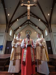 From left, Father Andrew Rowell, Bishop Jackson Nzerebende Tembo, and Father Eric Dudley pose at St. Peter's Anglican Church.