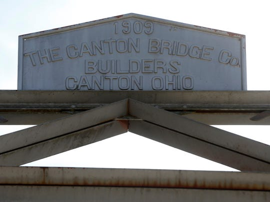 A sign on top of the Riverside Bridge in Ozark places