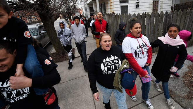 """People walk from Continental Square to Girard Avenue in York chanting """"Stop the violence"""" and """"Whose streets? Our streets!"""", during a Stop the Violence rally in York on Friday. This is the 4th such rally put on by organizers, and was followed by a march to Girard Avenue, the scene of a shooting earlier this week."""
