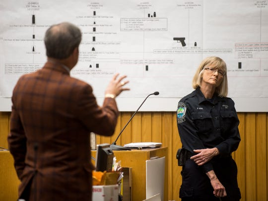 Patricia Resig, firearm examiner for the Knoxville Police Department, is questioned by defense attorney T. Scott Jones, left, during the Zaevion Dobson slaying trial at Knox County Criminal Court on Tuesday, Dec. 12, 2017.