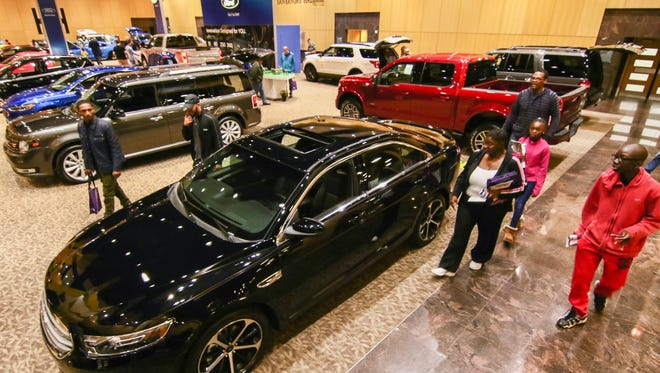Attendee review vehicles on display at the 10th annual Delaware Auto Show at The Chase Center on The Riverfront Saturday in Wilmington.