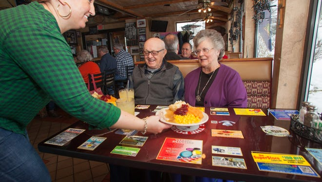 David and Ginger Isham of Willston surprised at the size of their Thanksgiving plate at the Pour House, Williston Road, South Burlington, Vermont.  KEVIN HURLEY/for the Free Press