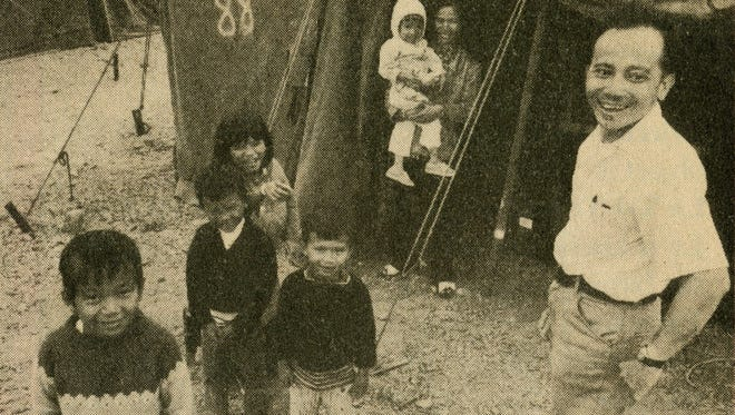 Family of Thuan Le Elston, third from left, in front of the refugee tent in 1975 at Camp Pendleton north of San Diego.