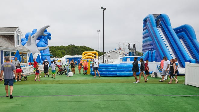The owner of Cape Cod Inflatable Park says the West Yarmouth operation is not a water park, despite the waterslides and pools there. Water parks are not yet allowed to reopen under the state's phased-in plan.