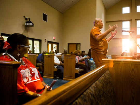 Maurice LaFate asks a question of panel members at a symposium on how to interact with police officers when stopped at the Canaan Baptist Church on Monday evening.