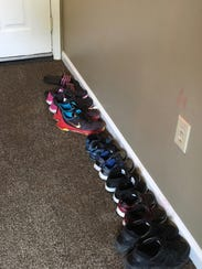 Shoes line the entryway inside Amanda Hall's Waynesboro