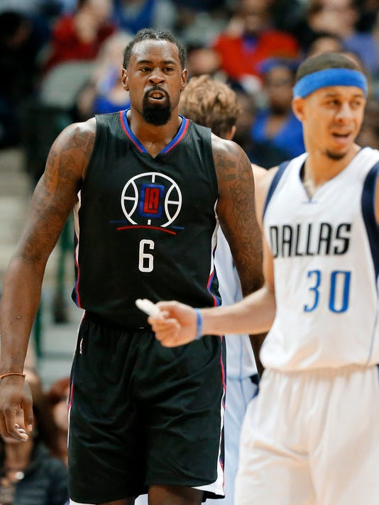 Los Angeles Clippers' DeAndre Jordan (6) walks up court behind Dallas Mavericks' Seth Curry (30) after scoring a basket in the second half of an NBA basketball game, Wednesday, Nov. 23, 2016, in Dallas. (AP Photo/Tony Gutierrez)