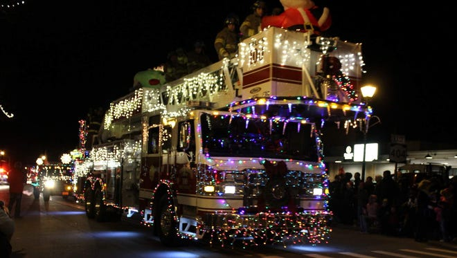 Even the biggest fire trucks get covered in Christmas lights for Webster's Electric Parade.