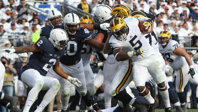 Michigan's Jabrill Peppers runs with the ball during the third quarter against the Penn State Nittany Lions at Beaver Stadium.
