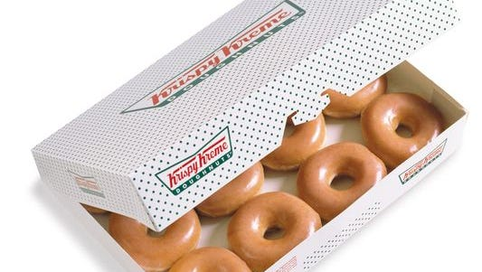 "Krispy Kreme apologized Tuesday after one of its U.K. stores advertised a club event called ""KKK."""