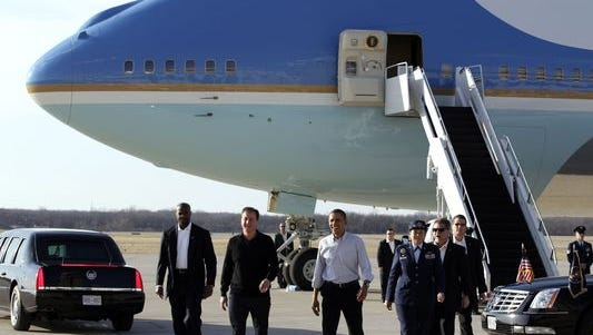 In this March 13, 2012, file photo, President Obama and Britain's Prime Minister David Cameron walk away from Air Force One after arriving at Wright-Patterson Air Force Base near Dayton, Ohio. The National Museum of the U.S. Air Force, located on Wright-Patterson Air Force Base, may someday add one of the two VC-25 presidential aircraft now serving as Air Force One to the museum's collection.