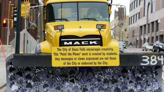 The city of Sioux Falls now will be be posting a disclaimer on all plows featuring artwork of students.